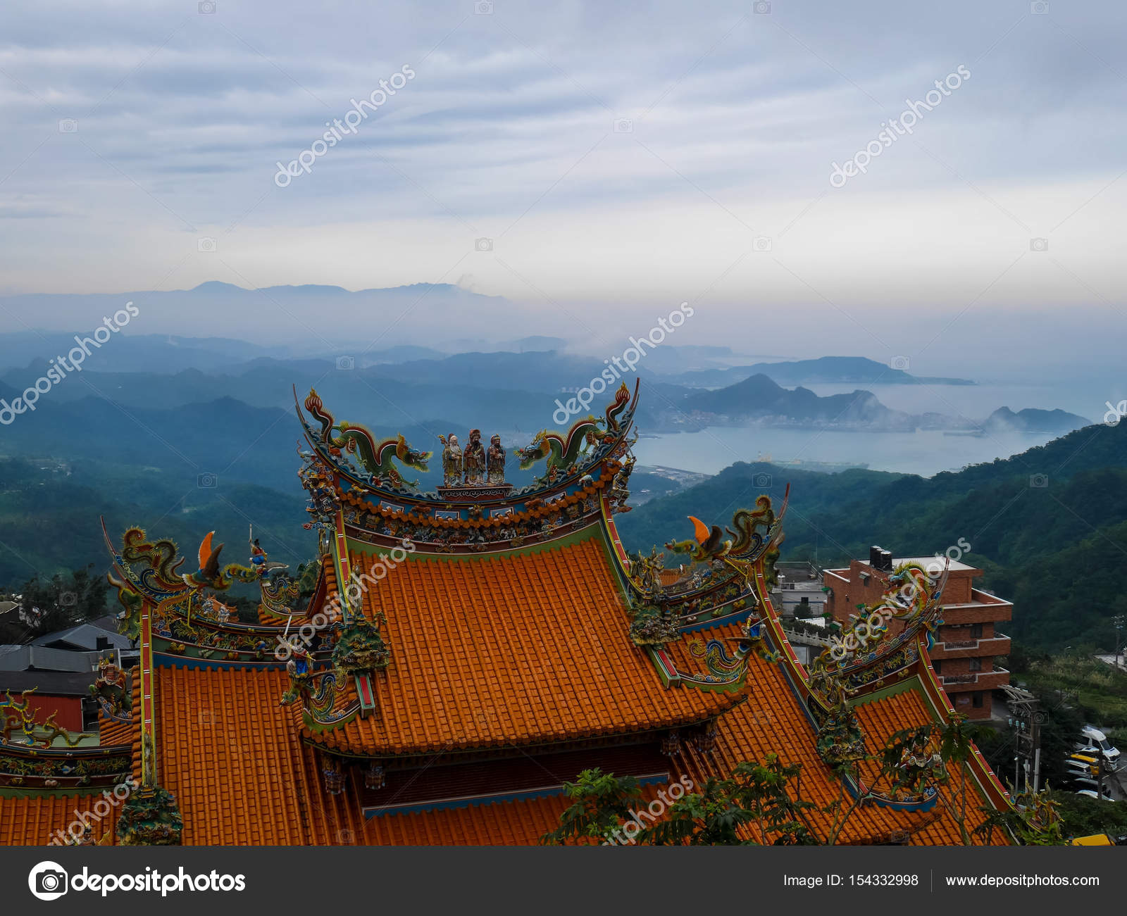 traditional chinese style roof in yellow with misty landscape se