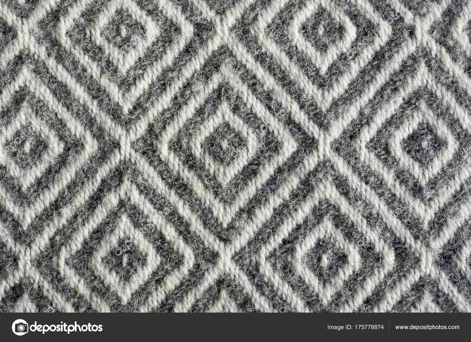 820fabf1a86f Primo piano di struttura del tessuto di lana. Rombi di contrasto grigio–  immagine stock