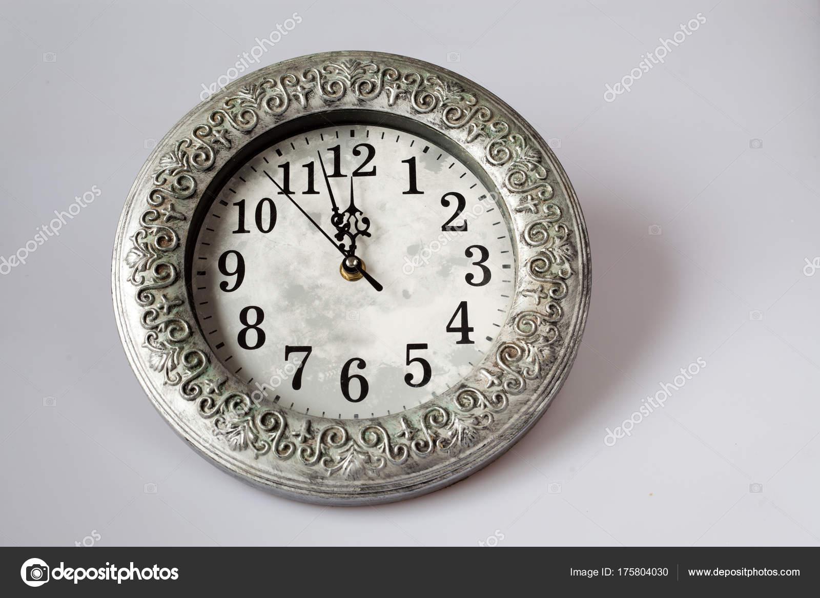 new Year\'s at midnight - clock at twelve o\'clock with holiday li ...