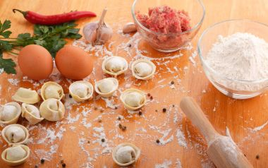 Homemade pelmeni with ingredients