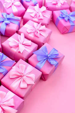 Decorative holiday gift boxes with pink color on pink background. Flat flat top view