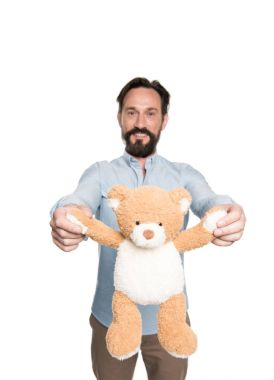 Bearded man with teddy bear