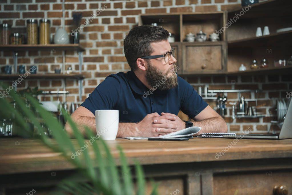 pensive man in eyeglasses