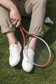 Fotografie Muž, který držel badminton raketa