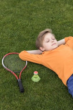 boy with badminton equipment