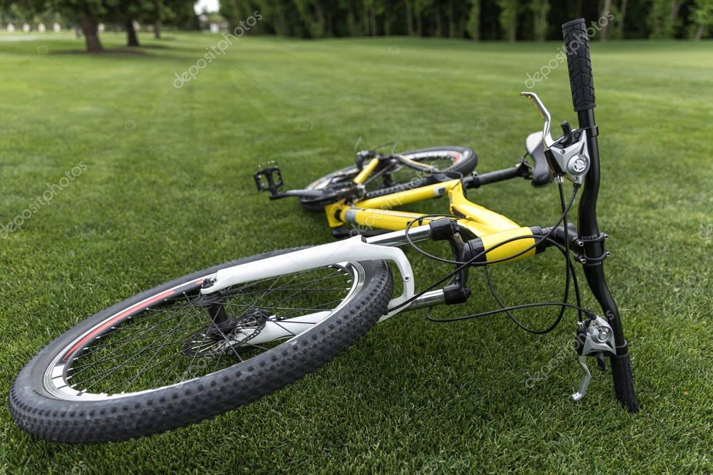 sport bicycle lying on grass in park