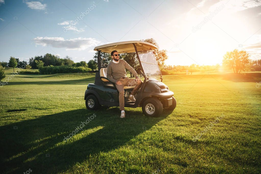 Man sitting in golf car
