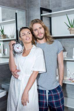 Couple with alarm clock