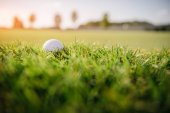 Fotografie Golf ball on grass