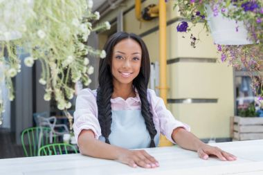 Young waitress in outdoor cafe