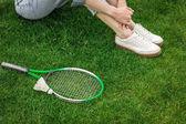 Žena a badmintonového vybavení