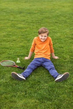 boy with badminton equipment