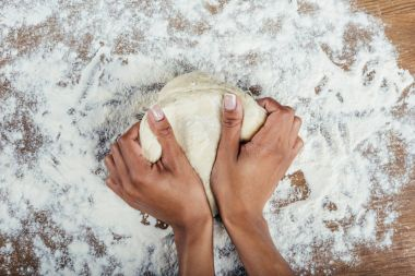 hands kneading dough