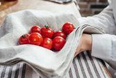 Fotografie Cherry tomatoes in napkin