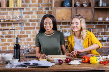 women cooking in kitchen