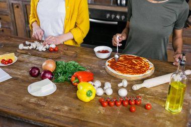Women cooking pizza