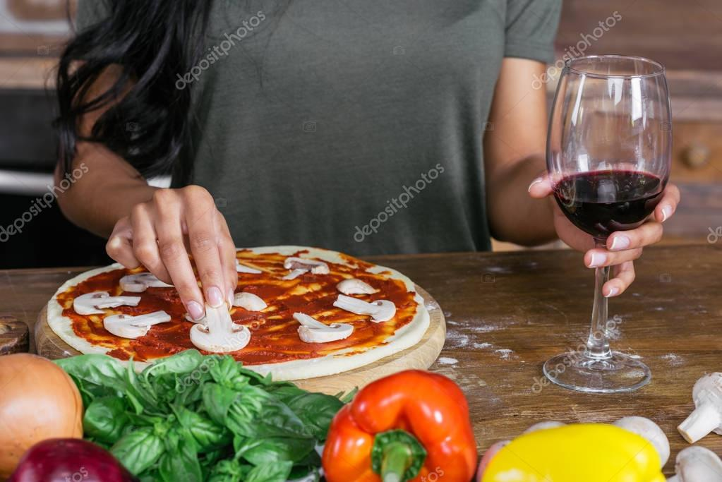 Woman cooking pizza