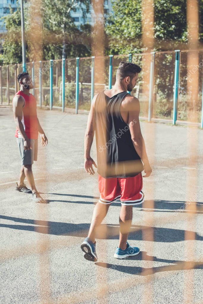 men on basketball court