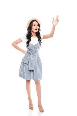 Young woman waving hand