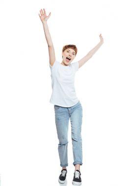 Cheerful girl raising hands