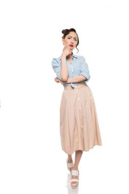 Gorgeous young woman in blouse and skirt stand with hand on chin, isolated on white stock vector