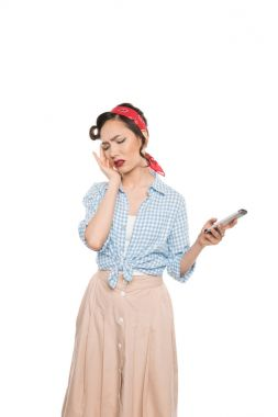 Asian woman with smartphone and headache