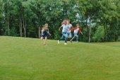 Multiethnic kids running in park