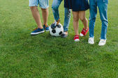 Photo Children standing with soccer ball