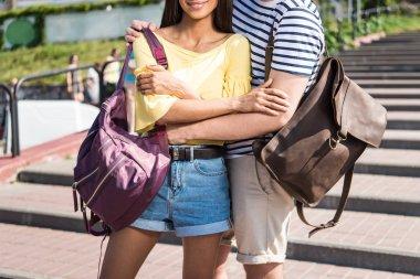 Multiethnic couple with backpacks
