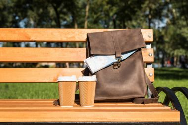 Leather bag and paper cups