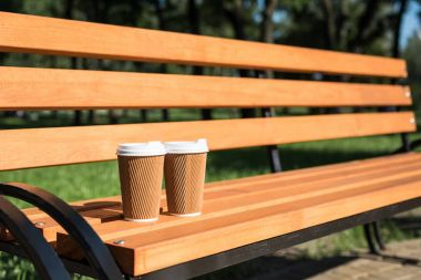 Disposable coffee cups on bench