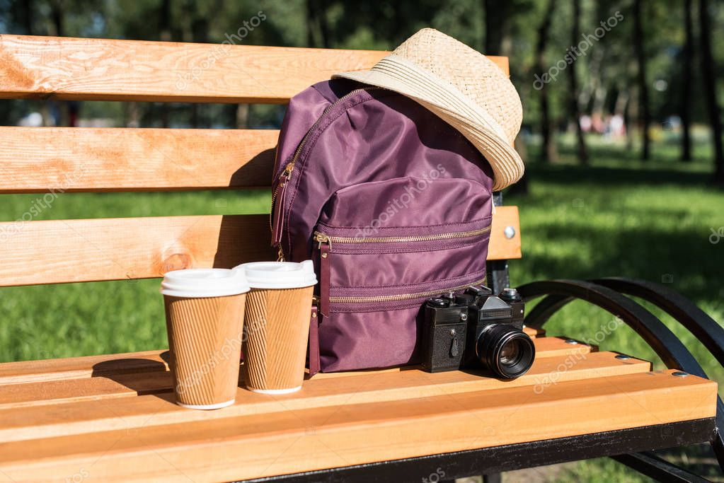 Backpack with camera and paper cups