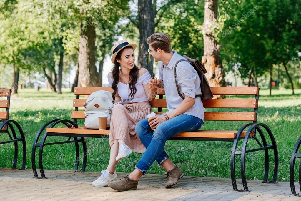다문화 부부 벤치에 앉아 — 스톡 사진 © IgorVetushko #160199746