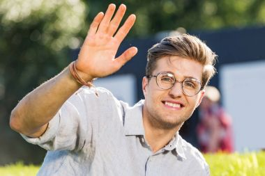 smiling young man in eyeglasses