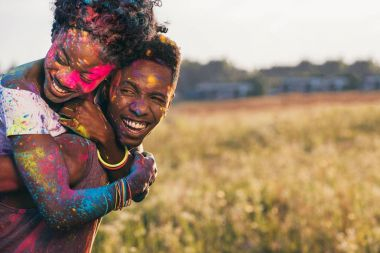 african american couple at holi festival