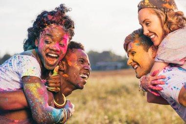 multiethnic couples at holi festival