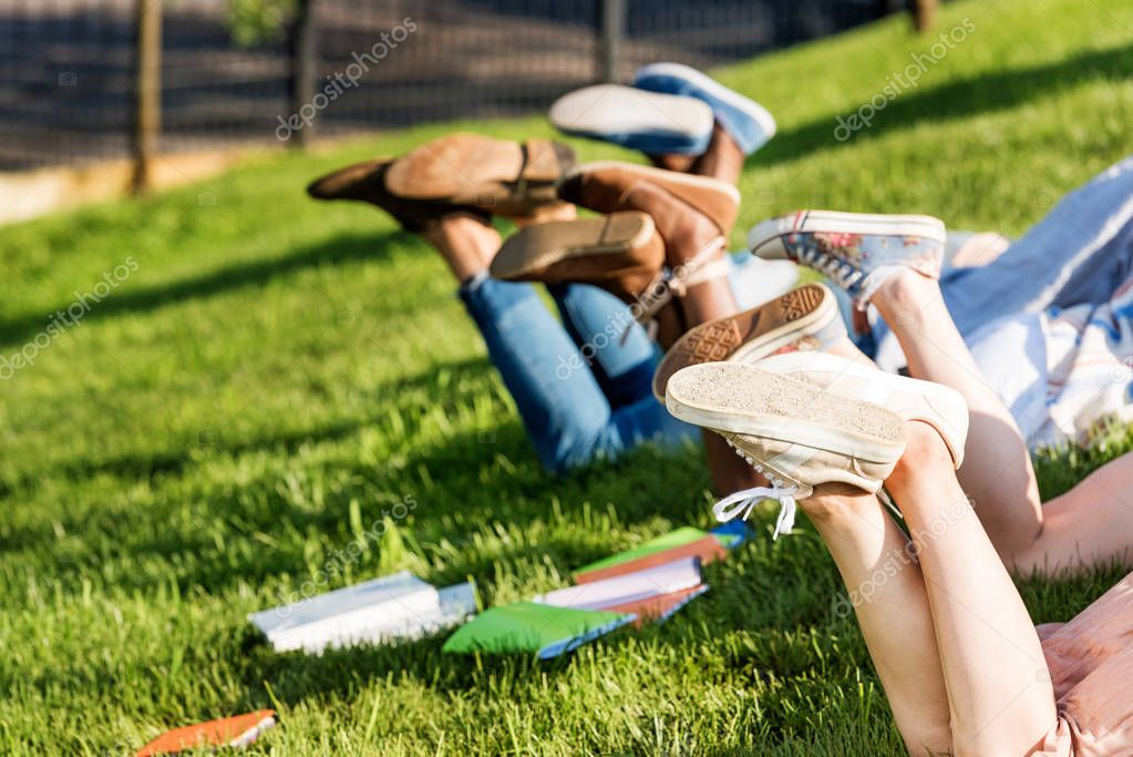 Students lying on grass