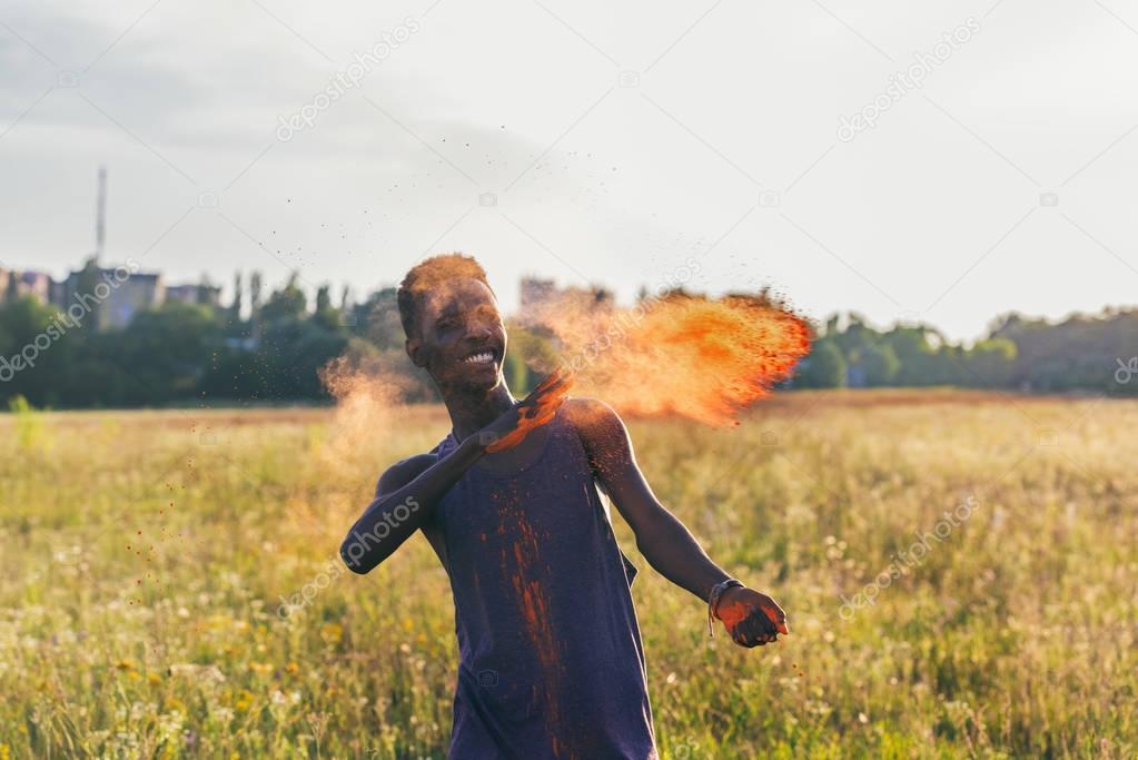 african american man on holi festival