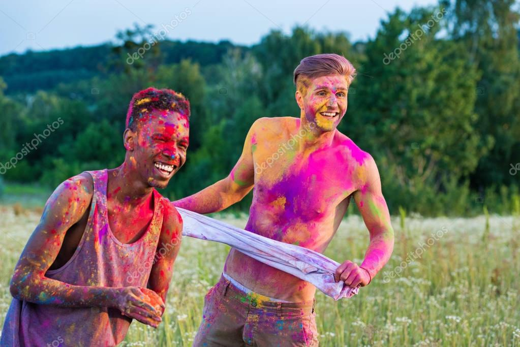 muticultural men at holi festival
