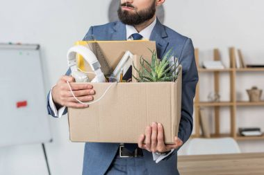 fired businessman with cardboard box