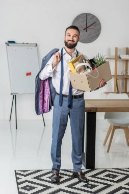 fired smiling businessman with cardboard box