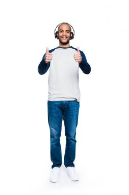 man in headphones with thumbs up