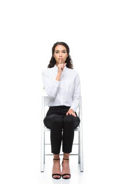 businesswoman with silence symbol