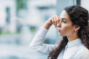 pensive brunette businesswoman