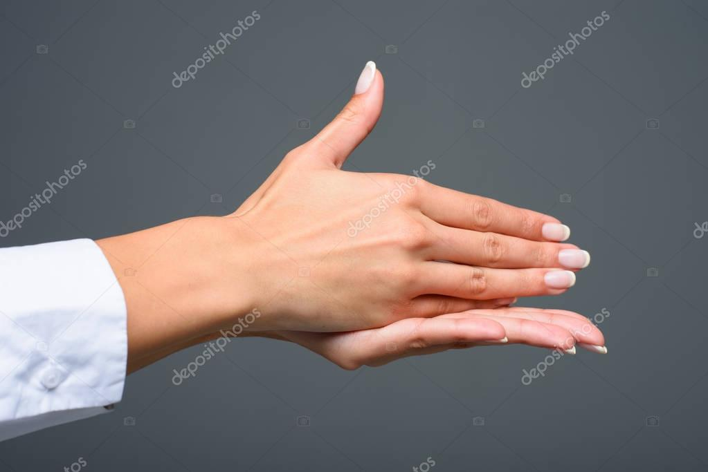 person gesturing signed language