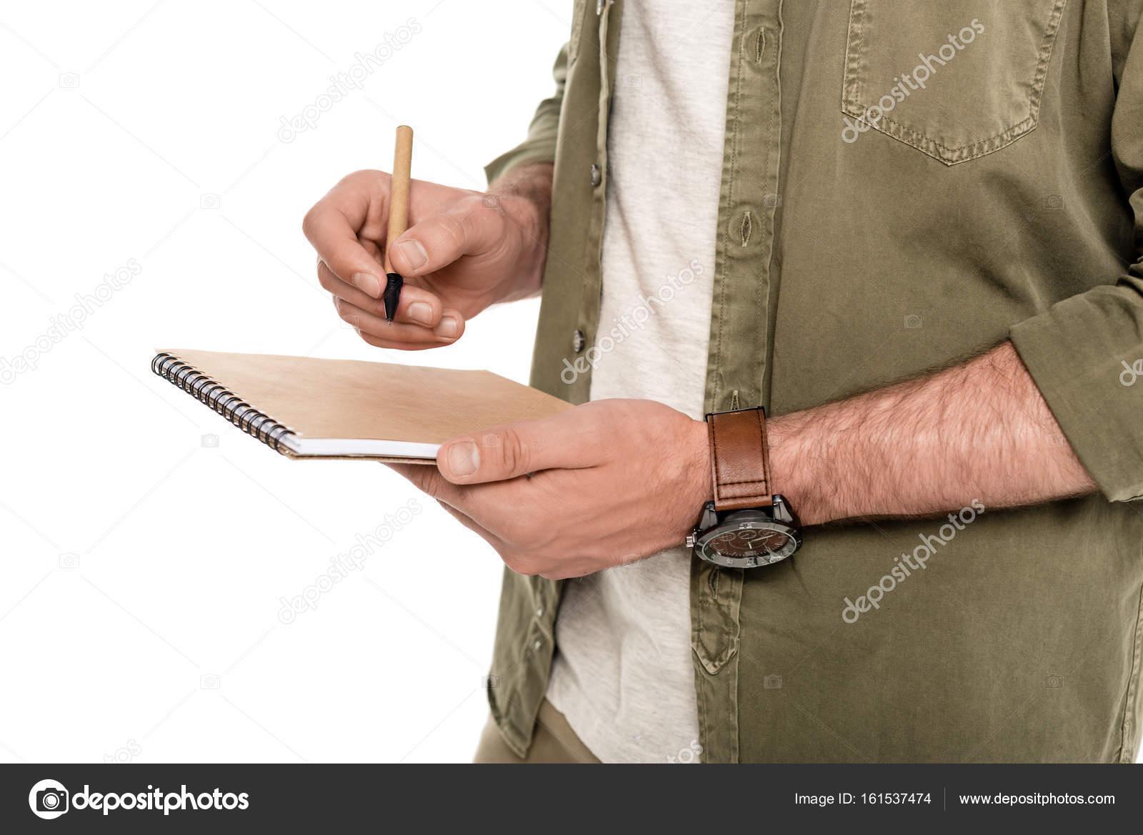 homme avec carnet et stylo en mains photographie igorvetushko 161537474. Black Bedroom Furniture Sets. Home Design Ideas