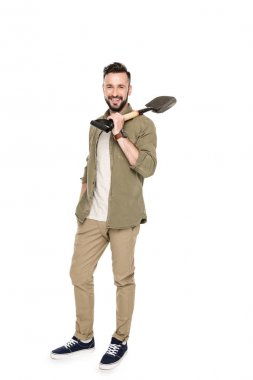 man holding shovel