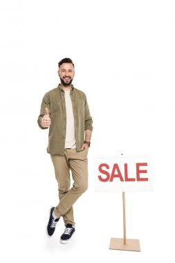 Man with sale sign showing thumb up