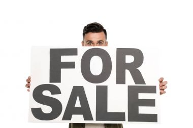 Obscured view of man with for sale banner in hands looking at camera isolated on white stock vector