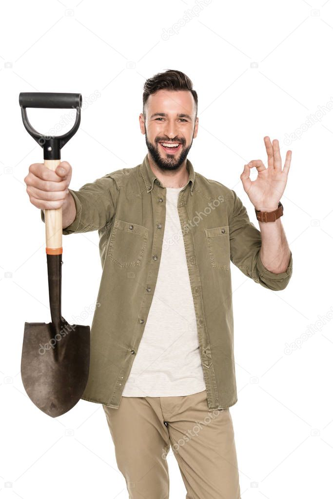 smiling man with shovel